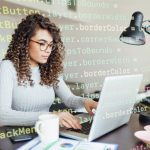 Woman coding at desk